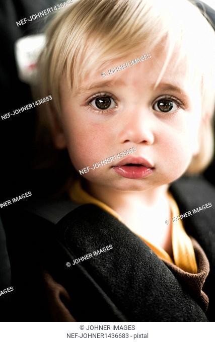 Portrait of boy in car seat