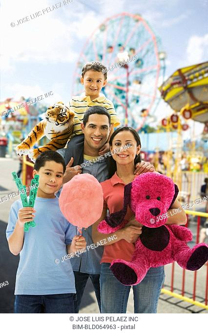 Hispanic family having fun at amusement park