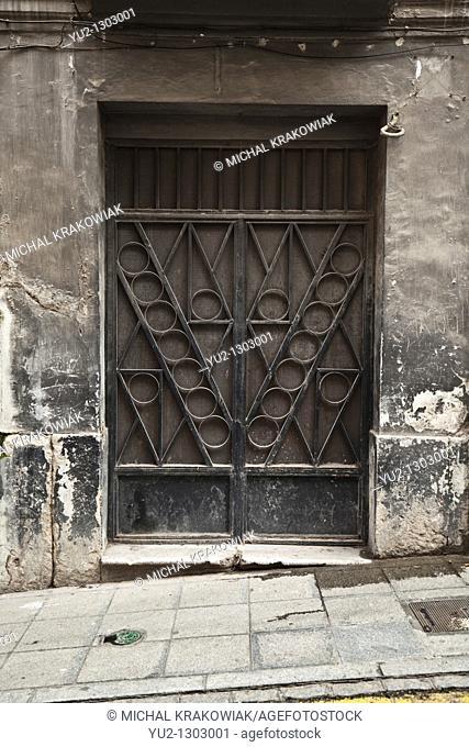 Ornate door of old townhouse in Granada, Spain