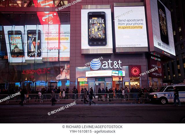 An AT&T cell phone store is surrounded by a massive electronic Sprint advertisement, seen in Times Square in New York