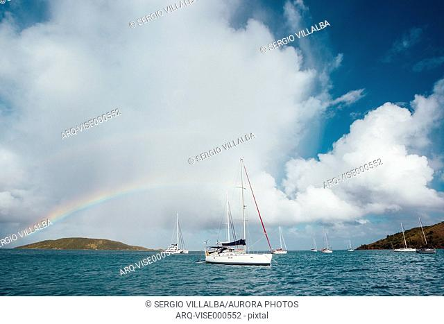 Rainbow over a sail boat in Prickly Pear Island, British Virgin Islands