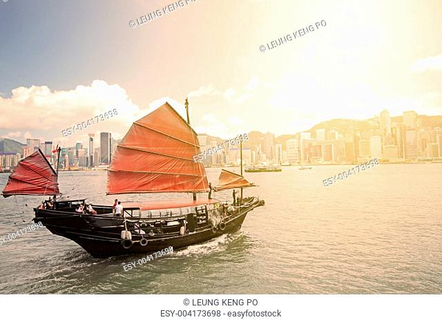 Junk boat with tourists in Hong Kong Victoria Harbour
