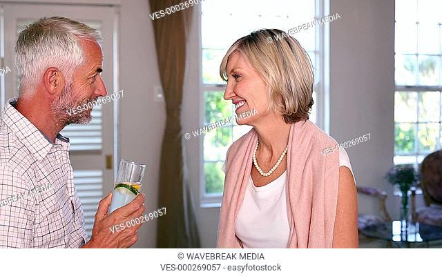 Happy couple drinking lemonade together