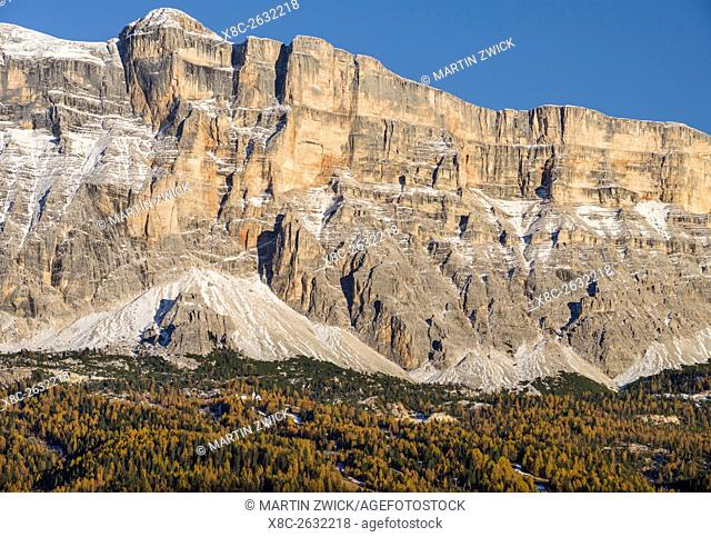 Mount Heiligkreuzkofel - Sasso di Santa Croce in Fanes mountain range in South Tyrol - Alto Adige. Church of pilgrimage Heilig Kreuz - San Croce dwarfed by the...