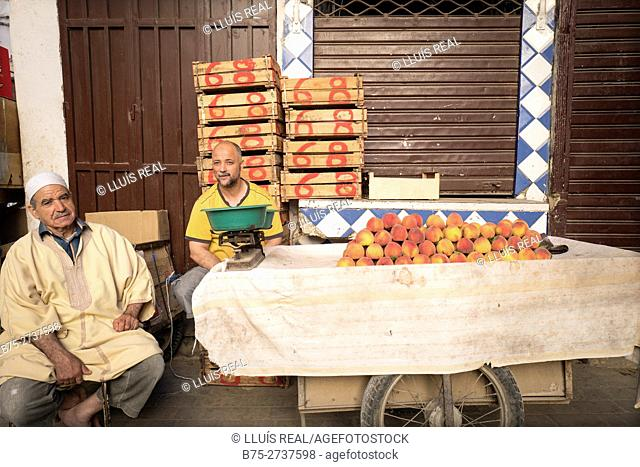 Two men selling peaches. Fez, Morocco