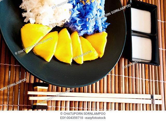 Thai style dessert, glutinous rice eat with mangoes
