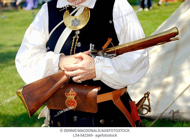 Early peiord miltia man in costume and gun Circa 1700 reenactment of the Colonial period lifestyle in Southeastern Michigan at the Feaste of Sainte Claire Port...