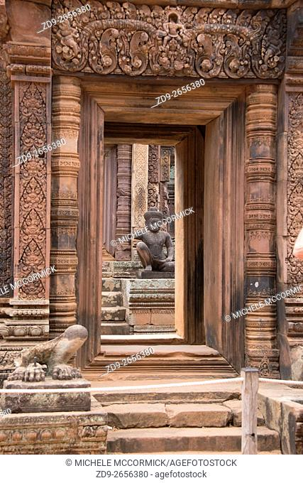 Elaborate carved pink stone distinguishes the temple of Banteay Srey