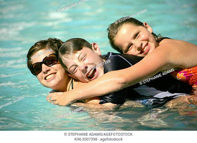 Family together in pool