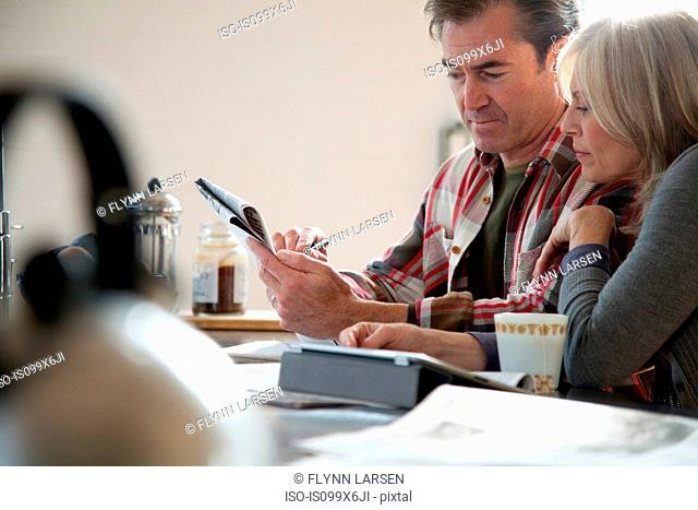 Couple doing crossword