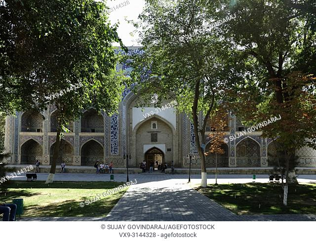 Bukhara, Uzbekistan - August 27, 2016: Tourists at Nadir Divan Begi Madrasah, well known architectural complex and one of the hot travel destination in...