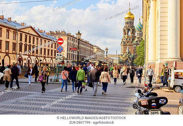Busy pedestrianised street next to the Griboedov Canal and Church on Spilled Blood, St Petersburg, Russia