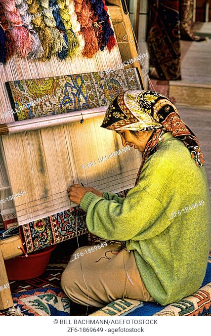 Portrait of woman making rugs by hand in Istanbul Turkey