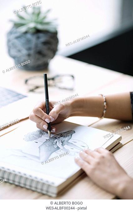 Woman's hand drawing, close-up