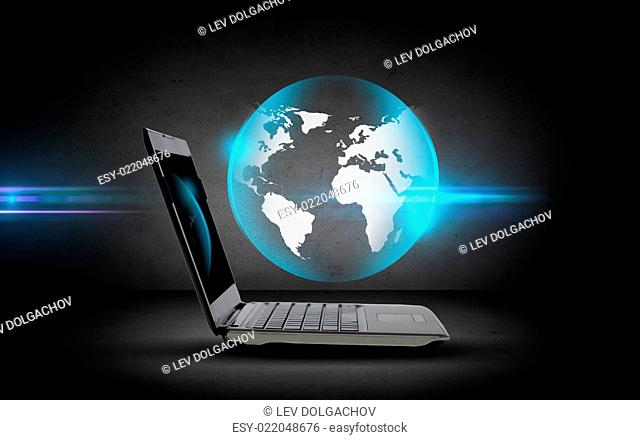 technology, business, mass media and internet concept - open laptop computer with globe projection over dark gray background