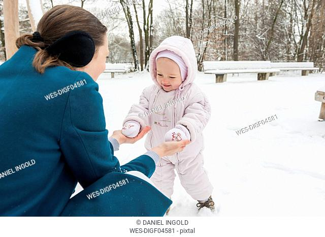 Mother and baby girl in snow