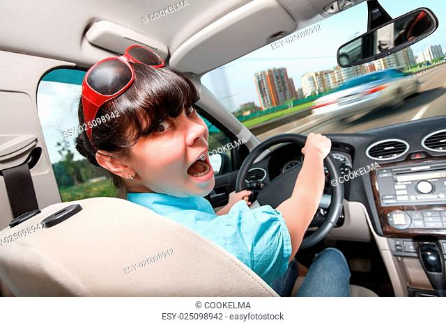 Driving lessons. The woman behind the wheel