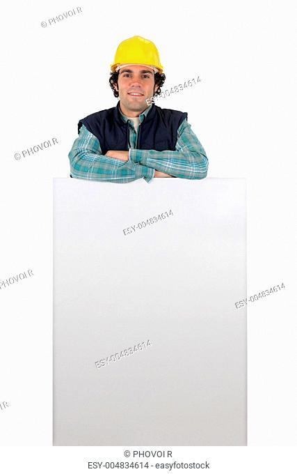 a workman with a panel