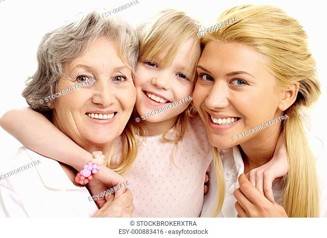 Photo of little girl clutching her grandmother and mother