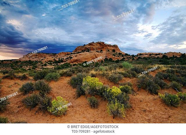 Storm clouds gather over an unnamed sandstone butte in the Sand Flats area east of Moab, Utah, USA