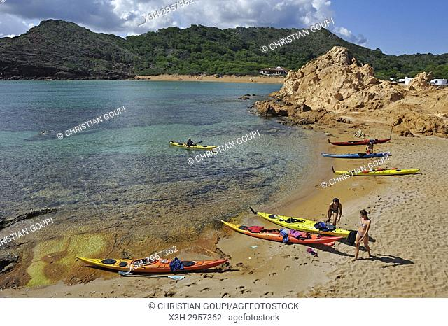 kayaks landing on an islet in the inlet Cala Pregonda near Cape Cavalleria on the North Coast of Menorca, Balearic Islands, Spain, Europe