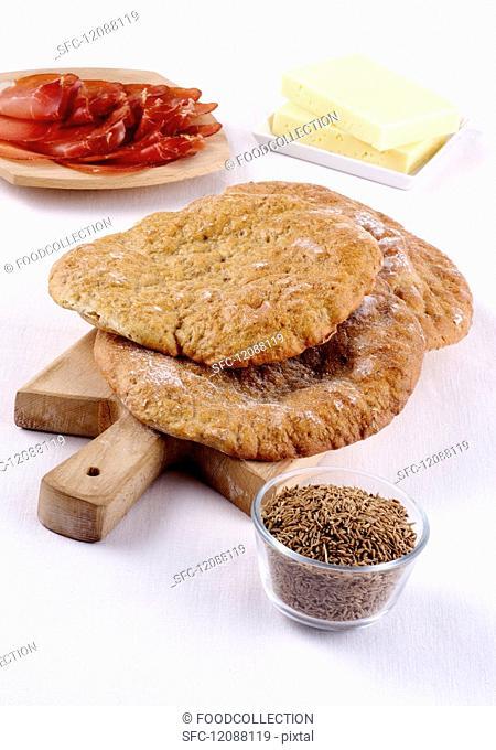Schüttelbrot (crispy unleavened bread from South Tyrol) on a chopping board