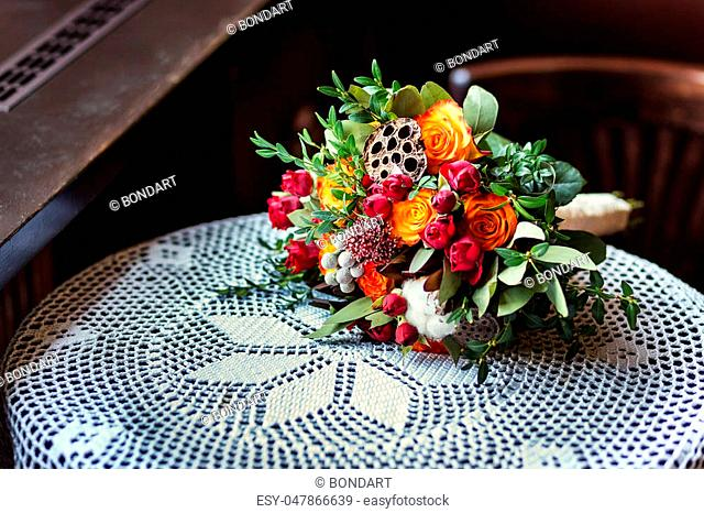 beautiful bridal bouquet lying on the table, a beautiful wedding bouquet, autumn flowers