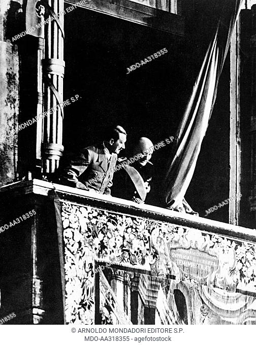 Mussoliniand Hitlerlooking outfrom the balconyof Palazzo Venezia. The German Chancellor Adolf Hitler and the Italian head of government Benito Mussolini...