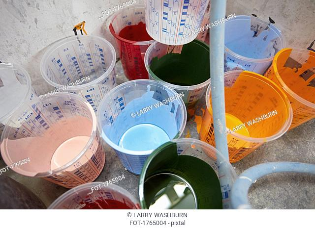 Vibrant, multicolor paint in buckets