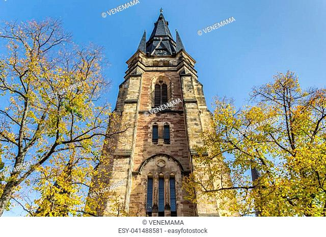 Fall colors and tower of the Liebfrauen church in Wernigerode, Germany