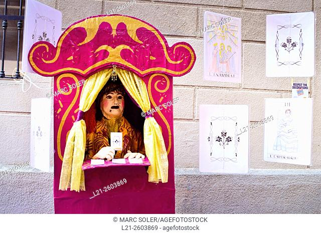 Puppet on a receipt showing tarot cards. Handmade decorations by residents. Festa Major de Gracia. Gracia Summer Festival. Barcelona, Catalonia, Spain