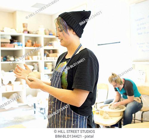 Student working in ceramics classroom