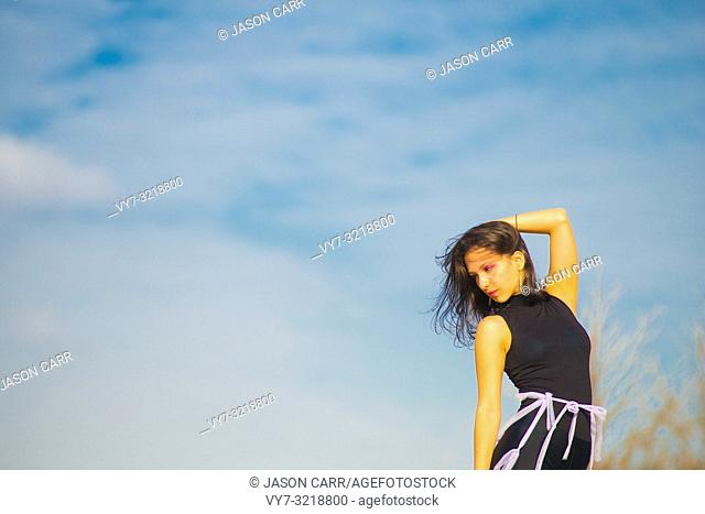 Latin female model poses for pictures in Barcelona, Spain. Barcelona's main languages spoken are Catalan and Spanish