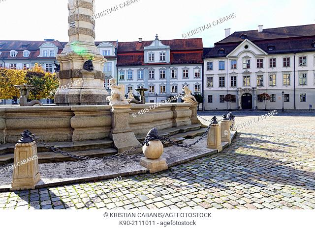 Facade of old houses and a part of the fountain at the Residence Square of Eichstaett, Bavaria, Germany, Europe