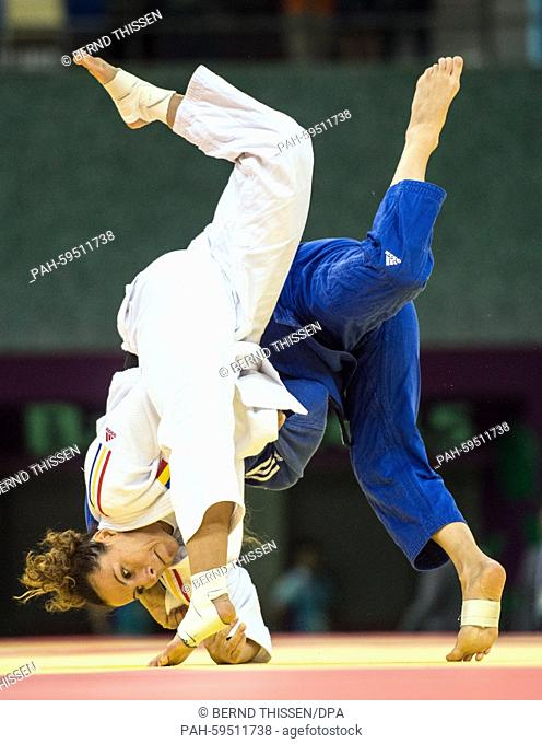 Germanys Mareen Kraeh (blue) competes with Andreea Chitu of Rumania in the Women's -52kg Judo Women's Semifinal of Table B at the Baku 2015 European Games in...