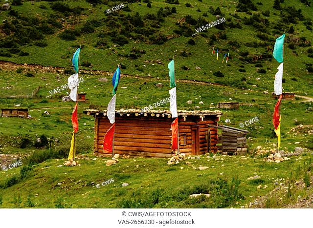 Batang country, Sichuan province, China - The view of the traditional Tibetan log cabin in the mountain