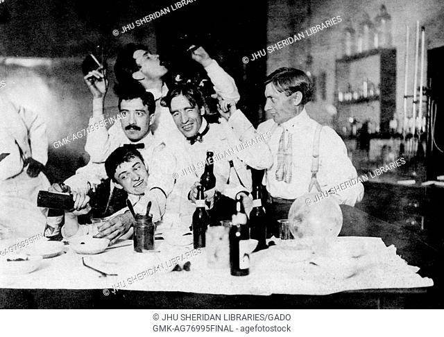 Group photograph of 1901 Johns Hopkins University PhDs drinking alcohol and partying in a chemistry lab, with one student drinking from a flask