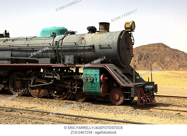 Preserved steam locomotive on the Hijaz Railway, near Wadi Rum, Jordan. An Old Turkish Steam Train Used In The Movie Lawrence Of Arabia Sits In The Saudi Desert...