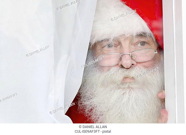 Santa Claus looking out of window
