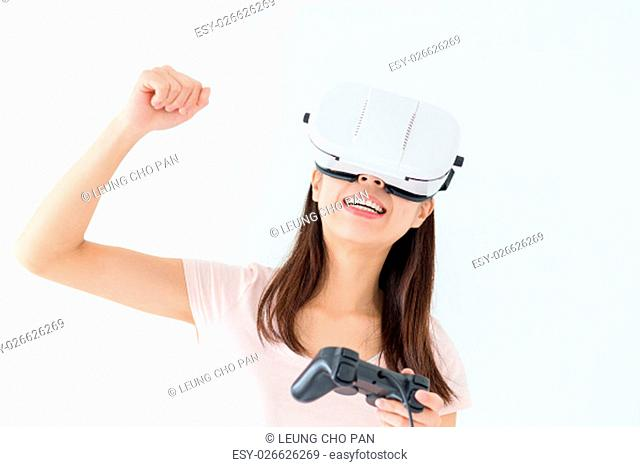 Woman wearing virtual reality goggles playing video games