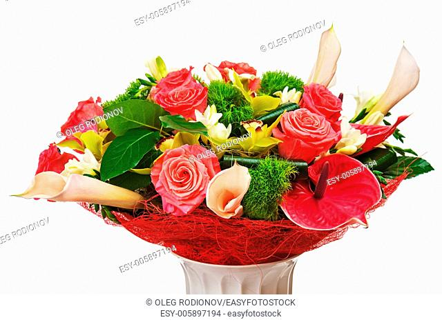 Colorful flower bouquet arrangement centerpiece in vase isolated on white background. Closeup