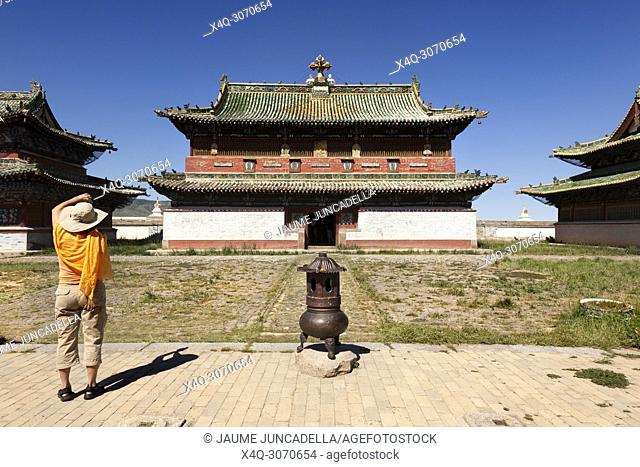 Tourist taking a picture in front of the monastery of Erdene Zuu with courtyard