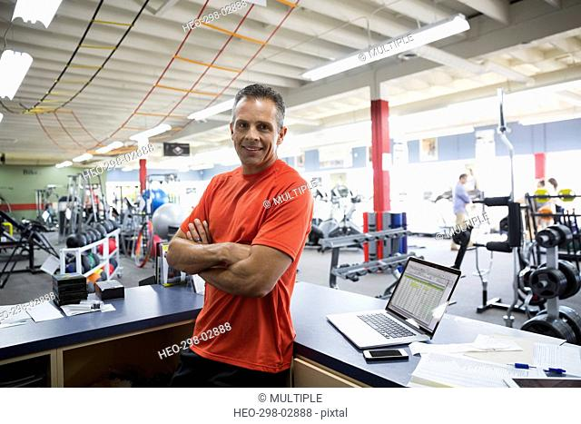 Portrait confident business owner working in home gym equipment store
