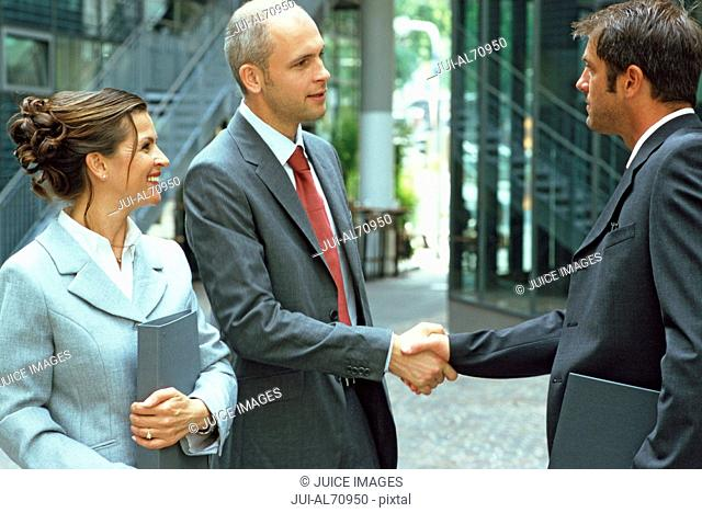 Two businessmen shaking hands on a deal