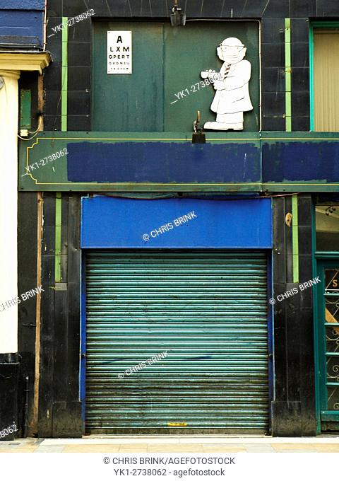 Closed down optician shop in Liverpool Merseyside UK