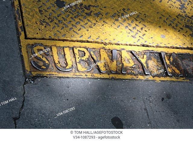 A cast iron lid/sign of the New York subway