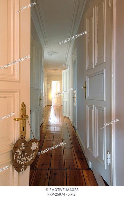 Welcome sign at door knob and floor