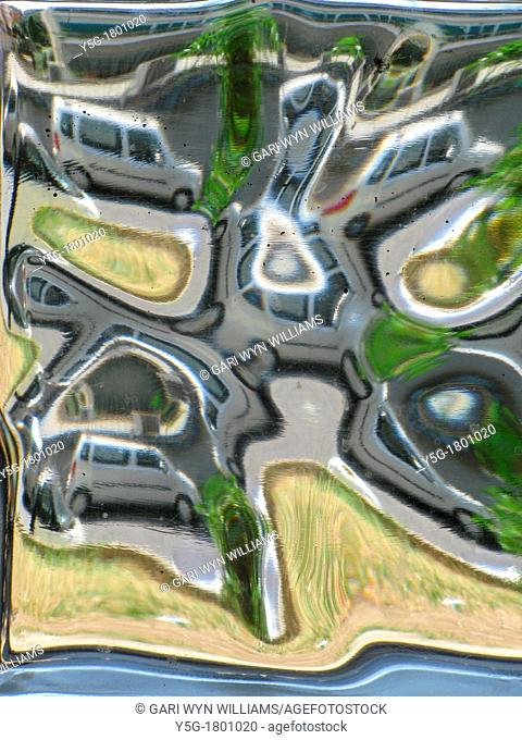 abstract distorted image of street scene in rome italy through thick glass window