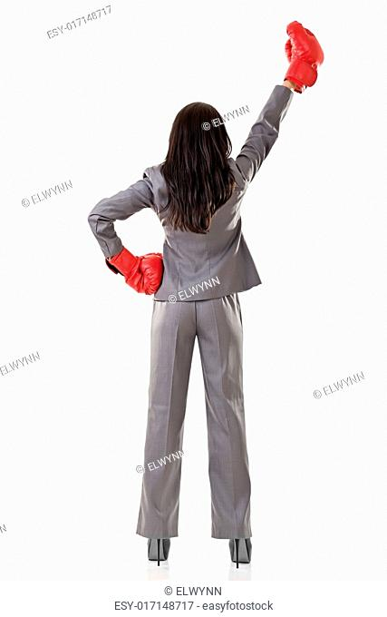 Young attractive Asian business woman with boxing gloves are ready for battle. Rear view. Isolated on the white background