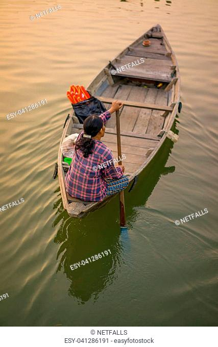 A woman rowing boat in Cai Rang Vietnam